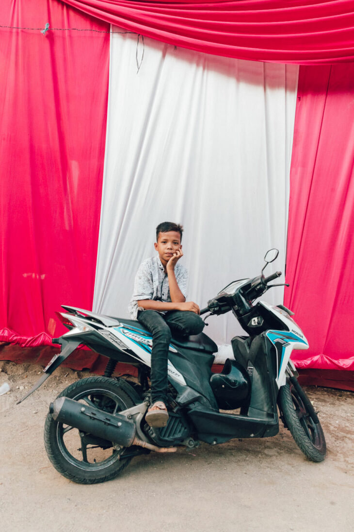 little boy on motorbike